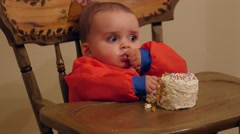Messy baby boy eating his birthday cake with his family Stock Footage