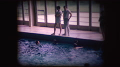 Vintage 8mm footage of a crowded pool - stock footage