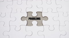 Stock Video Footage of Problems & Solutions - on white jigsaw puzzle with hand completing the puzzle. S