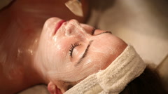 Facial Treatment Above Applying Cream Stock Footage