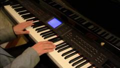 Close up of a man's hands playing a piano. Making music. Stock Footage