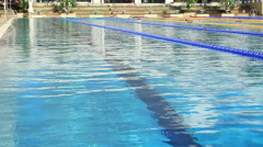 Olympic Size Swimming Pool In Outdoor Gym Swimmers in Background Stock Footage
