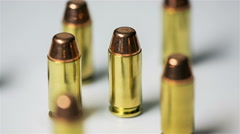 Bullets Rotate on Table Loop Stock Footage