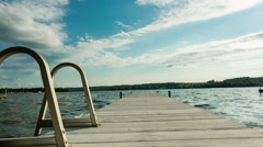 Lake Dock with Ladder Pull Back and Move Forward Stock Footage