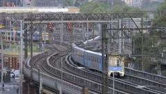Trains departing and arriving at a station Stock Footage