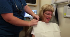 Dental Attach Bib to Patient Stock Footage