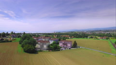 4K aerial drone shot - little town surrounded by fields - stock footage
