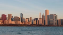 Pan Left Chicago skyline time-lapse at sunrise w/sky transition Stock Footage