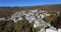 Flight over from of the picturesque village of Monodendri in Zagori area Stock Footage