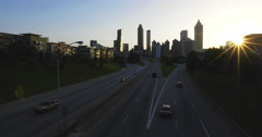 Atlanta City Skyline Sun Setting Far Right with Flare - stock footage