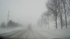 POV dashcam driving in heavy snowstorm and blizzard Stock Footage