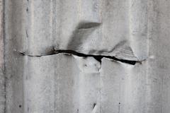 Cut in corrugated metal sheet - stock photo
