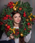 Stock Photo of Girl and a Christmas wreath.