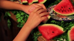 Arranging slices of watermelon Stock Footage