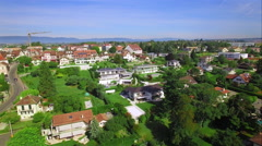 4K aerial shot - flying over a little village - European country side Stock Footage