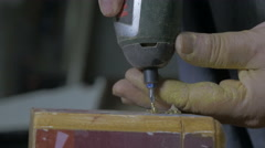 Carpenter drilling hole and howling screws with electric tools, hands close up. Stock Footage