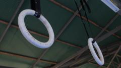 Gymnastic Olympic Rings Hanging From Gym Ceiling Exercise Training Equipment Stock Footage