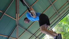 Low Angle Athlete Training Muscle Ups On Gymnastic Rings Slow Motion Stock Footage
