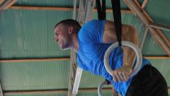 Athlete Performing Muscle Ups On Gymnastics Rings CrossFit Training Workout - stock footage