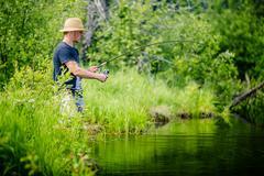 Young Fisherman Catching a big Fish - stock photo