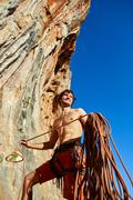 climber with the rope - stock photo