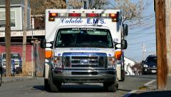 Emergency medical responders ambulance truck Stock Footage