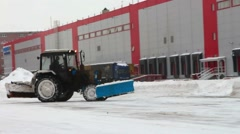 Removing snow with plow, close up of iron snowplow pushing a lot of snow away - stock footage