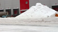 Stock Video Footage of tractor cleans snow on the territory of the warehouses