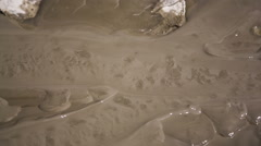 Grey Mud Flowing Out Of Active Diaper Volcano Stock Footage