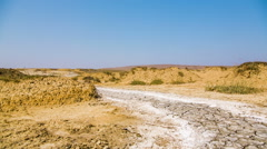 Desert Road With Hardened Volcano Mud At The Valley Stock Footage