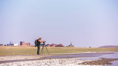 Cameraman Making Video At Mud Volcano Valley, Crimea Stock Footage