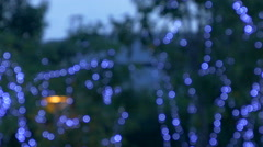 Blurred blinking Christmas lights at Night Stock Footage