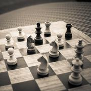 Wooden Chess board Business strategy idea concept background. Vintage dark co - stock photo