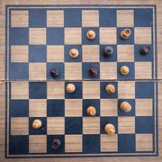 Wooden Chess board Business strategy idea concept background. Vintage dark co Stock Photos