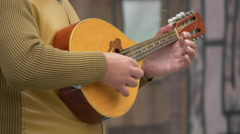 Musician playing a mandolin in Brasov Stock Footage