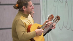 Two musicians playing a mandolin and a guitar in Brasov Stock Footage