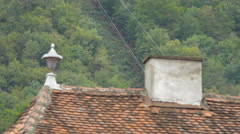 Old roof tiles and a chimney near Tampa mountain, Brasov Stock Footage