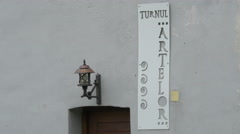 Arts Tower sign on a white wall in Brasov Stock Footage