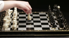Chess board with two players - stock footage