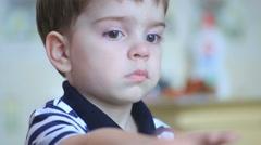 Mum feeds the little boy porridge Stock Footage