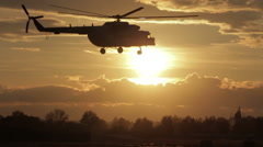 Russian helicopter takes off at sunset - stock footage