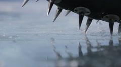 Stock Video Footage of Bike wheel studs crumble ice