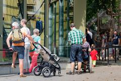 Visitors admiring apes in the zoo of Antwerp - stock photo