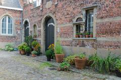 Beguinage with old historic houses downtown in Antwerp, Belgium - stock photo