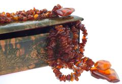 amber necklace in a indian leather case - stock photo