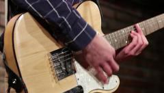Hands play the electric guitar with the help of a mediator. Chords, close-up - stock footage
