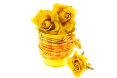 dry yellow roses in bucket with orange ribbon - stock photo