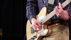 Close up of musician playing the guitar on the strings with chords Stock Footage