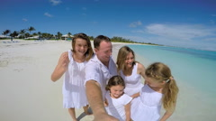 Selfie portrait of happy young Caucasian family on the beach Stock Footage