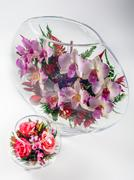 Flowers in a glass aquarium - stock photo